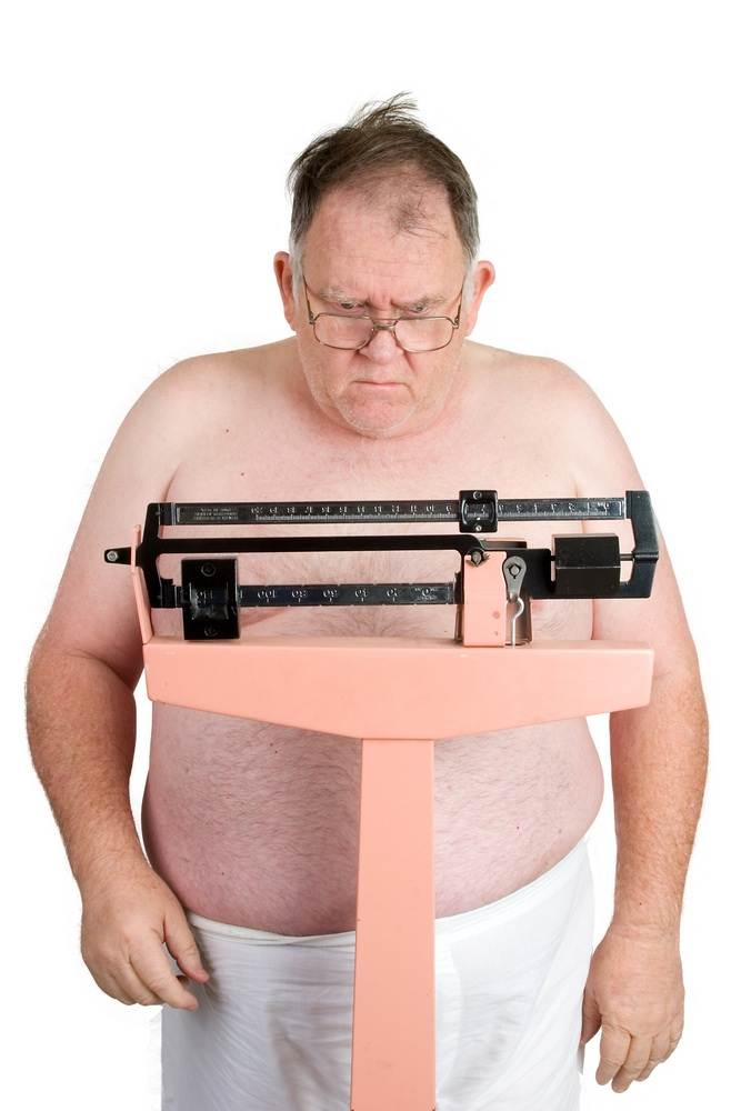 Fat man weighing